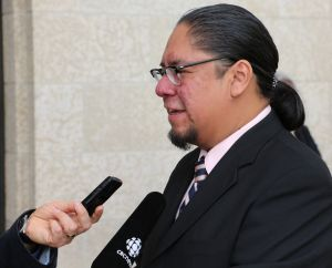 Winnipeg, June, 5, 2015: At the Manitoba Legislative Building, Maeengan Linklater answers journalists questions about his proposed Manitoba Indian Residential Schools Genocide and Reconciliation Memorial Day Act. Photo: Paul S. Graham